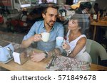 man talking to woman with cup... | Shutterstock . vector #571849678
