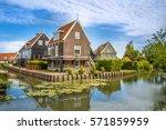 beautiful typical fisherman... | Shutterstock . vector #571859959