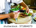 chef making traditional... | Shutterstock . vector #571884073