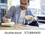 talented handsome male blogger... | Shutterstock . vector #571884400