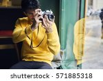male hipster tourist dressed in ... | Shutterstock . vector #571885318