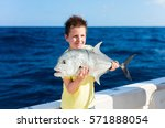 Lucky Teenage Boy Holding Fish...