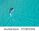 people are playing a jet ski in ... | Shutterstock . vector #571891546