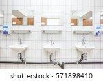 in an public restroom hangs on...   Shutterstock . vector #571898410