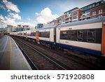 overground train passing ... | Shutterstock . vector #571920808