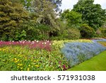Large Flower Bed And Trees