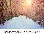 A Man Jogging Down A Snowy Pat...