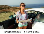 young pretty woman see the map... | Shutterstock . vector #571951453