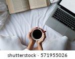 relaxing young woman enjoying... | Shutterstock . vector #571955026