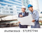asian engineer talking to a... | Shutterstock . vector #571957744