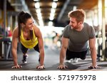 female and male compete in... | Shutterstock . vector #571975978