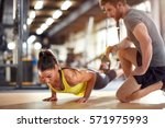 fitness instructor with girl on ... | Shutterstock . vector #571975993
