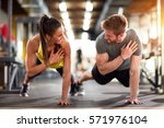 man and woman strengthen hands ... | Shutterstock . vector #571976104