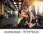 kiss from fitness partner as... | Shutterstock . vector #571976113