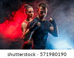 strong boxer in stance with... | Shutterstock . vector #571980190