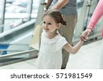 close up of young girl holding... | Shutterstock . vector #571981549