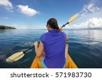 young woman in a kayak ... | Shutterstock . vector #571983730