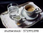 cup of coffee  milk pot  a... | Shutterstock . vector #571991398