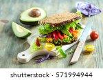 vegan rye sandwich with fresh... | Shutterstock . vector #571994944