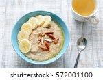 oatmeal porridge bowl with... | Shutterstock . vector #572001100