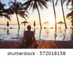 relaxation on the beach  young... | Shutterstock . vector #572018158