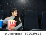 keeping a seat for a friend.... | Shutterstock . vector #572039638