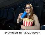 modern cinema. happy young... | Shutterstock . vector #572040994