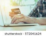 online payment man's hands... | Shutterstock . vector #572041624