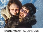 winter portrait of beau and...   Shutterstock . vector #572043958