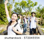 happy young group hiking... | Shutterstock . vector #572045554