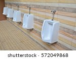 Small photo of Urinals in the men's bathroom with white ceramic urinals design of white men in the toilet. Oblique/Canted angle shot.