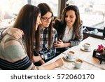 close female friends meeting in ... | Shutterstock . vector #572060170
