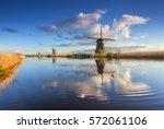Windmills At Sunrise. Rustic...