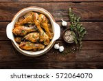 roasted chicken legs on rustic... | Shutterstock . vector #572064070