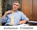 businessman sweating in his... | Shutterstock . vector #572068330