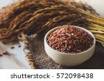 close up of brown rice in white ... | Shutterstock . vector #572098438