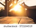 hand of woman practicing... | Shutterstock . vector #572104519