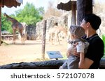 cute toddler boy with interest...   Shutterstock . vector #572107078