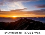 rising sun from the summit of... | Shutterstock . vector #572117986