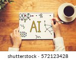 ai text with a person holding a ... | Shutterstock . vector #572123428