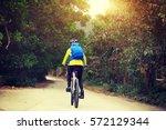 young woman riding mountain...   Shutterstock . vector #572129344