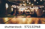 image of wooden table in front... | Shutterstock . vector #572132968