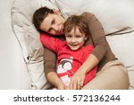 mother with  little son dressed ... | Shutterstock . vector #572136244