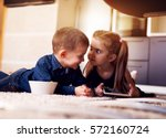 brother and sister having fun... | Shutterstock . vector #572160724
