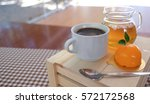 a cup of coffee with flower... | Shutterstock . vector #572172568