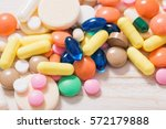 different  pills  mix  on white ... | Shutterstock . vector #572179888