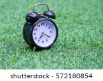 Retro Alarm Clock On Grass