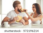beautiful young couple is... | Shutterstock . vector #572196214