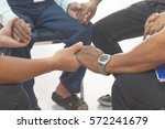 group of different men praying... | Shutterstock . vector #572241679