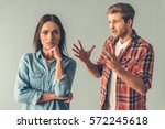young couple having a quarrel.... | Shutterstock . vector #572245618